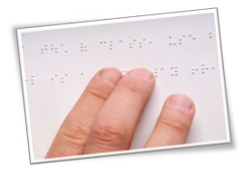Student reading Braille